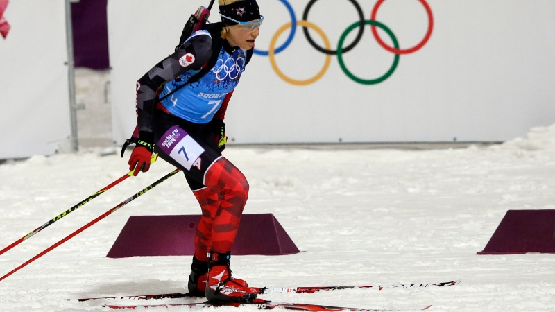 FILE - Canada's Zina Kocher competes during the women's biathlon 4x6k relay at the 2014 Winter Olympics in Krasnaya Polyana, Russia, Friday, Feb. 21, 2014. (AP / Lee Jin-man)