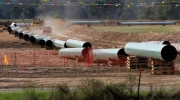 In this Oct. 4, 2012 file photo, large sections of pipe are shown on a neighboring property to Julia Trigg Crawford family farm, in Sumner Texas. (AP Photo/Tony Gutierrez, file)