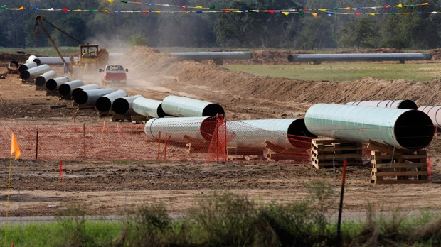 In this Oct. 4, 2012 file photo, large sections of pipe are shown on a neighboring property to Julia Trigg Crawford family farm, in Sumner Texas. Keystone XL is expected to be cancelled on President-elect Joe Biden's first day in office. (AP Photo/Tony Gutierrez, file)