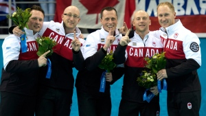 Canada skip Brad Jacobs, Ryan Fry, E.J.Harnden, Ryan Harnden and Caleb Flaxey stand on the podium after winning the gold medal in the Olympic curling final action at the Sochi Winter Olympics Friday, Feb. 21, 2014 in Sochi, Russia. (Adrian Wyld / THE CANADIAN PRESS)