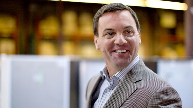 PC Leader Tim Hudak returns to his campaign bus after speaking to journalists at a warehouse in Etobicoke, Ont., during his election campaign for the Ontario Premiership on Monday, Sept. 19, 2011. (Chris Young / THE CANADIAN PRESS)