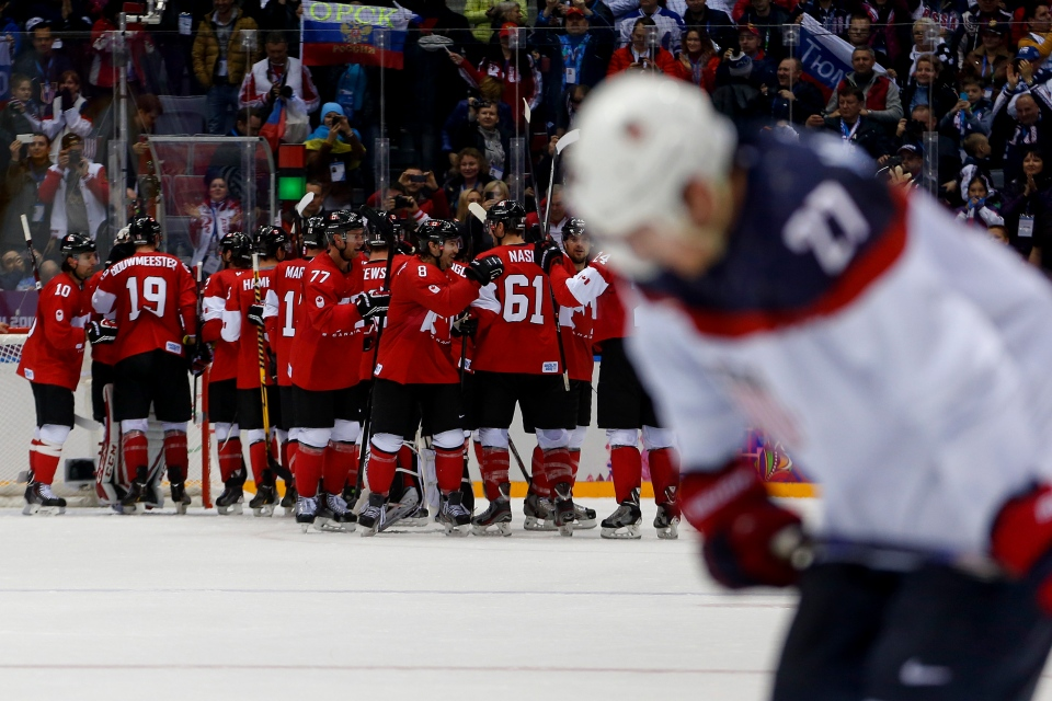 Team Canada celebrates after beating the USA 1-0 in a men's semifinal ice hockey game at the 2014 Winter Olympics, Friday, Feb. 21, 2014. (AP / Petr David Josek)