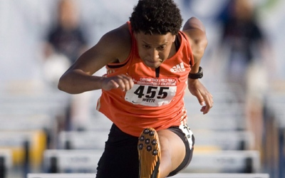 Canada's Angela Whyte races in the 100-metre hurdles at the Canadian Track and Field Trials in Windsor, Ont. on Friday, July 4, 2008. (Adrian Wyld, THE CANADIAN PRESS)