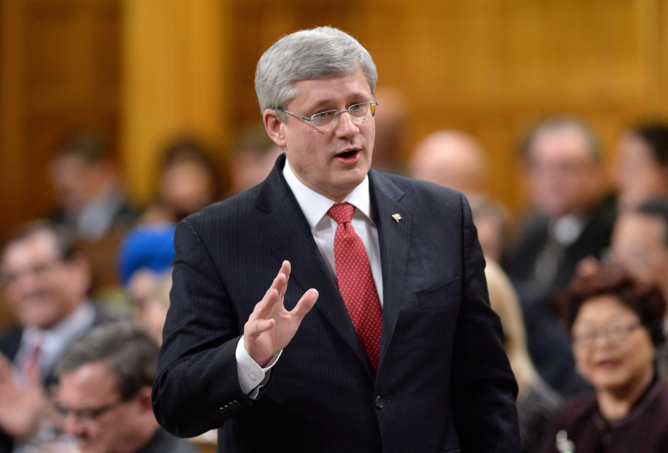 Prime Minister Stephen responds to a question during question period in the House of Commons on Parliament Hill in Ottawa on Wednesday, February 12, 2014. (Sean Kilpatrick / THE CANADIAN PRESS)