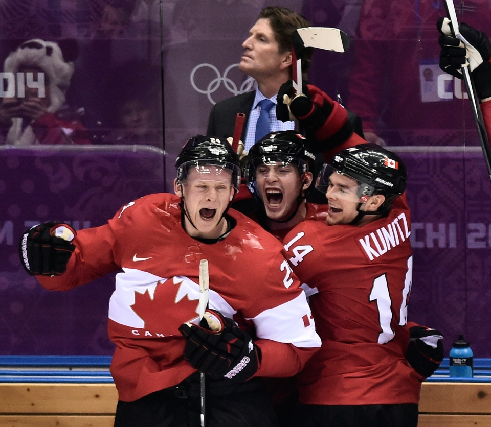 Team Canada players Corey Perry, left, Matt Duchene, centre, and Chris Kunitz, right celebrate after defeating the U.S. at the 2014 Sochi Winter Olympics in Sochi, Russia on Friday, Feb. 21, 2014. (Nathan Denette / THE CANADIAN PRESS)