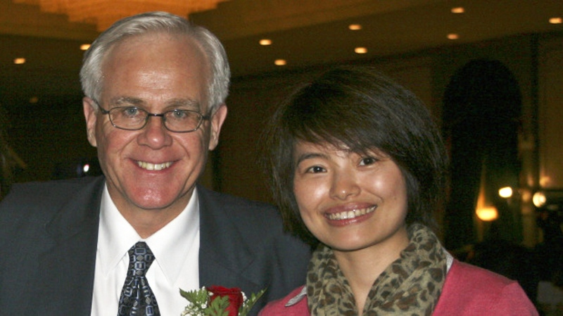 Xinhua News Agency journalist Shi Rong is seen  with Conservative MP Bob Dechert.