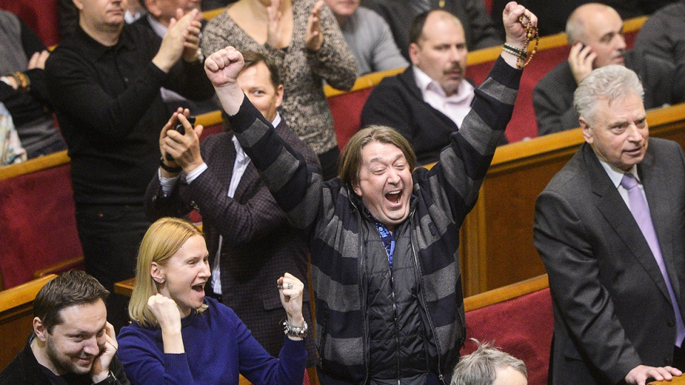 Ukrainian lawmakers celebrate after voting new laws in parliament in Kyiv, Ukraine, Friday, Feb. 21, 2014. (AP / Andrew Kravchenko)