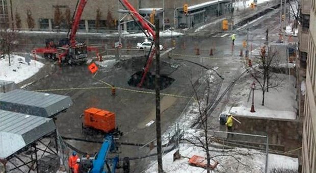 Work on a portion of Ottawa's $2 billion dollar Light Rail project has been suspended while the City of Ottawa investigates the cause of a massive sinkhole on Waller Avenue.