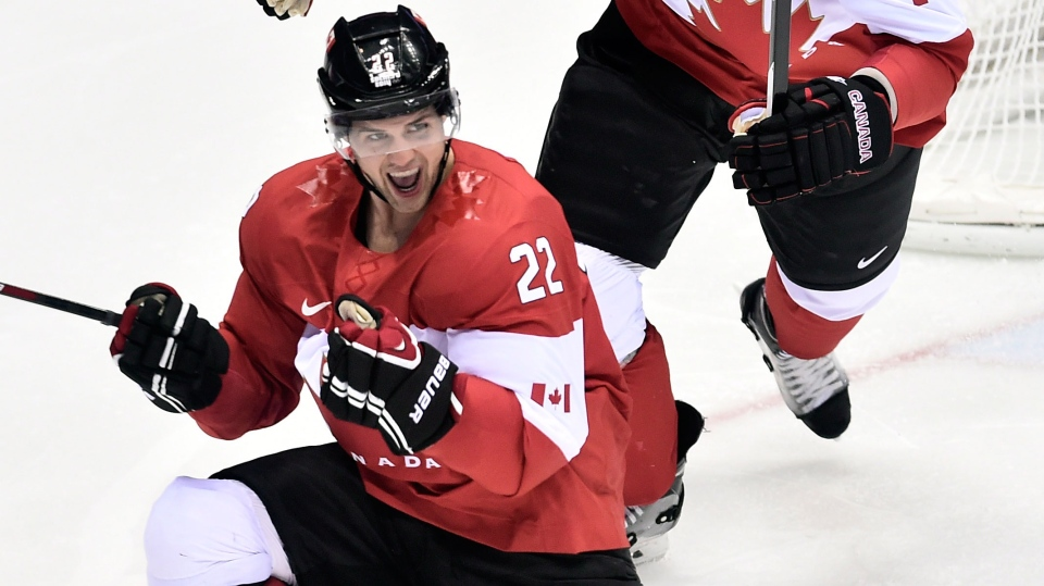 Canada's Jamie Benn celebrates after scoring the first goal against United States' during second period hockey semi-final action at the 2014 Sochi Winter Olympics in Sochi, Russia on Friday, February 21, 2014. (Nathan Denette / THE CANADIAN PRESS)