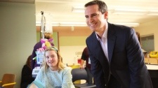 Ontario Premier Dalton McGuinty talks with patients and 14-year old Katie Hopper during a campaign stop at the Children's Hospital of Eastern Ontario in Ottawa on Monday, Sept. 19, 2011. THE CANADIAN PRESS/ Patrick Doyle