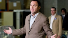 PC Leader Tim Hudak speaks to journalists at a media availability in a warehouse in Etobicoke, Ontario during his election campaign for the Ontario Premiership on Monday September 19, 2011. THE CANADIAN PRESS/Chris Young