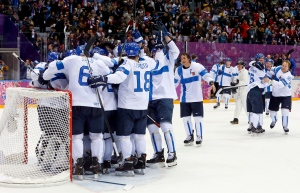 Team Finland celebrates after beating the U.S. 5-0 in the men's bronze-medal hockey game at the 2014 Winter Olympics in Sochi, on Feb. 22, 2014. (AP / Mark Humphrey)
