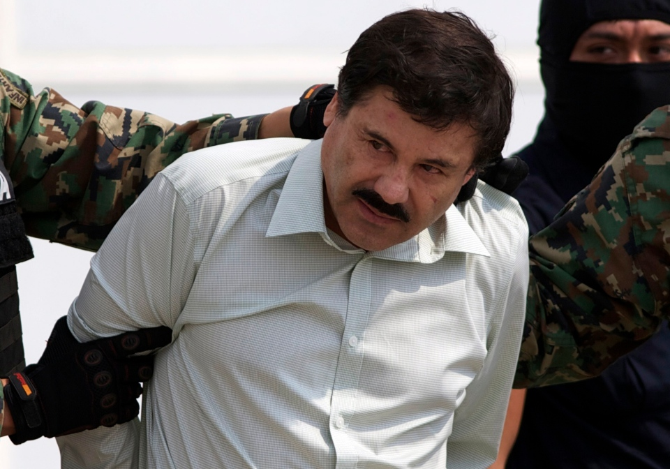 "Joaquin ""El Chapo"" Guzman is escorted to a helicopter in handcuffs by Mexican navy marines at a navy hanger in Mexico City on Saturday, Feb. 22, 2014. (AP/Eduardo Verdugo)"