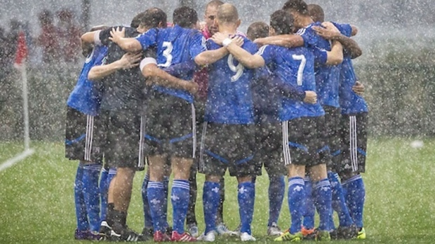 The Impact are seen huddling in the rain in Orland
