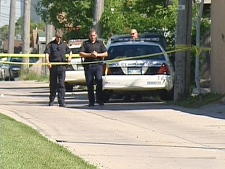 Officers cordon off the area where the taser incident happened in Winnipeg, Tuesday, July 22, 2008.