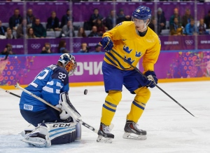 Finland goalkeeper Kari Lehtonen blocks a shot off a rebound by Sweden forward Nicklas Backstrom during the first period of a men's semifinal ice hockey game at the 2014 Winter Olympics, Friday, Feb. 21, 2014, in Sochi, Russia. (AP Photo/Petr David Josek)