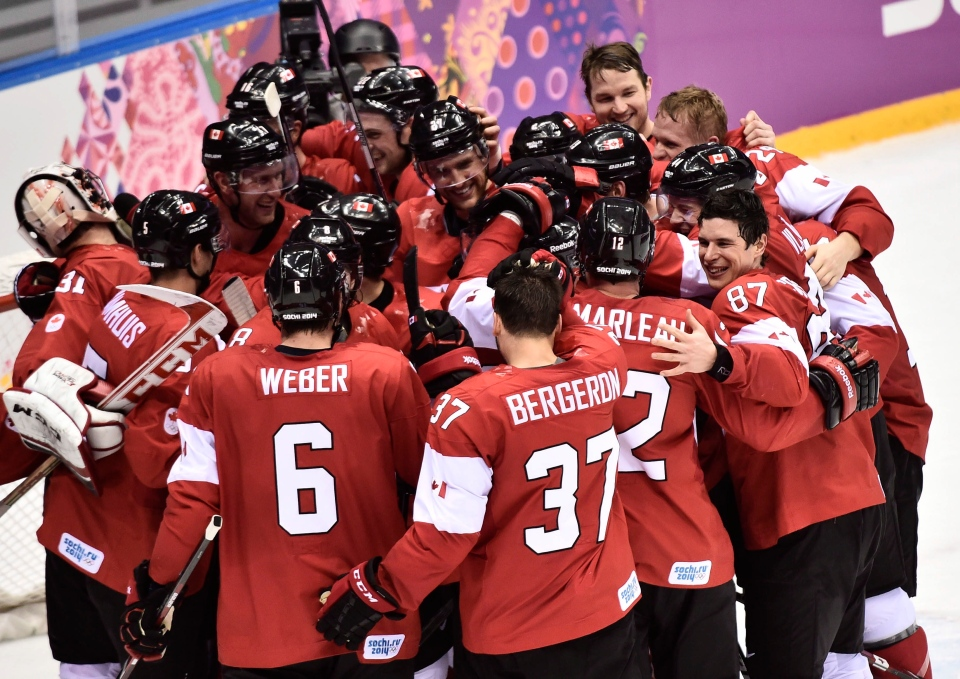 Canada celebrates their win over Sweden in the gold medal game at the 2014 Sochi Winter Olympics in Sochi, Russsia, on Sunday, Feb. 23, 2014. (Nathan Denette / THE CANADIAN PRESS)