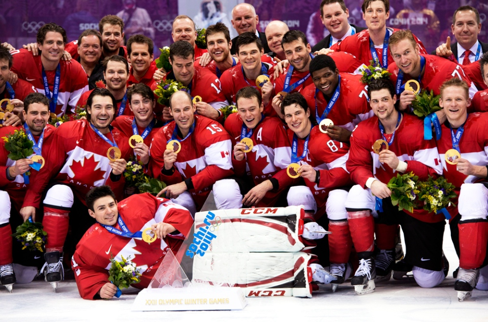 Team Canada celebrate with their gold medals after defeating Team Sweden to win the gold medal in Olympic final action at the Sochi Winter Olympics in Sochi, Russia, Sunday, Feb. 23, 2014. (Paul Chiasson / CANADIAN PRESS)