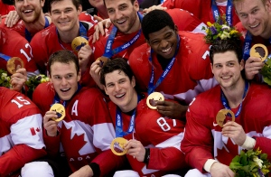 <b>Canada wins gold! Day 16 at Sochi </b> <br><br>In a thrilling gold medal game, Team Canada beat Team Sweden 3 to 0 to take top honours in men's hockey. <br><br> Team Canada captain Sidney Crosby celebrates with other Canada players after defeating Team Sweden to win the gold medal in Olympic final action at the Sochi Winter Olympics in Sochi, Russia, Sunday, Feb. 23, 2014. (Paul Chiasson / THE CANADIAN PRESS)