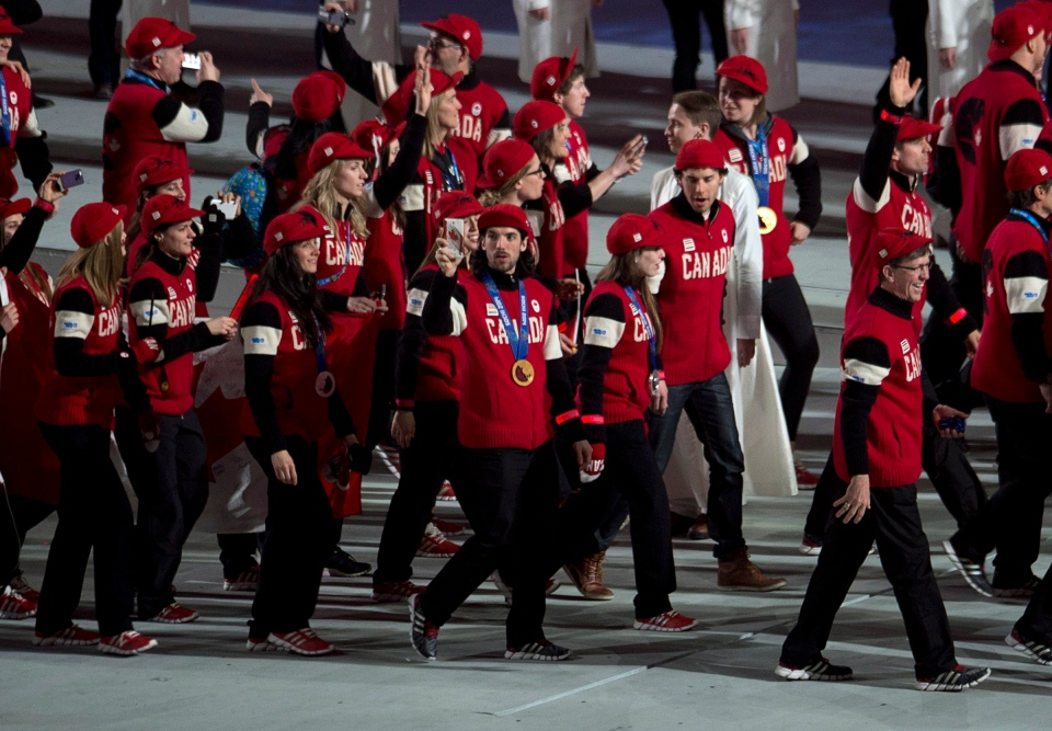 Members of the Canadian team enter the stadium for the closing ceremonies for the Sochi Winter Olympics in Sochi, Russia, Sunday, Feb. 23, 2014. (Adrian Wyld / THE CANADIAN PRESS)