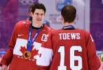 Men's hockey gold medallist Sidney Crosby celebrates with teammate Jonathan Toews after beating Sweden 3-0 in the final at the Sochi Winter Olympics in Sochi, Sunday, Feb. 23, 2014. (Paul Chiasson / THE CANADIAN PRESS)