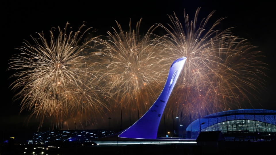 Fireworks burst over the Olympic cauldron during the closing ceremony of the 2014 Winter Olympics in Sochi, Russia, Sunday, Feb. 23, 2014. (AP / Julio Cortez)