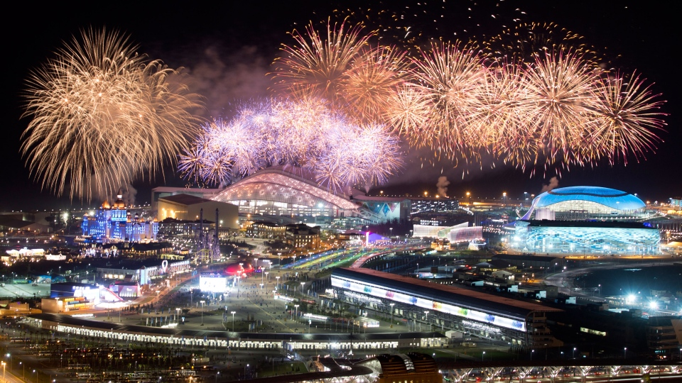 Fireworks explode over Olympic Park at the end of the closing ceremony of the 2014 Winter Olympics in Sochi, Russia, Sunday, Feb. 23, 2014. (AP / Pavel Golovkin)