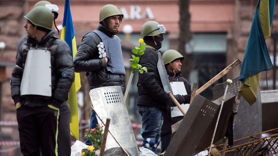 Protesters man a barricade in central Kyiv, Ukraine, Sunday, Feb. 23, 2014. (AP / Darko Bandic)