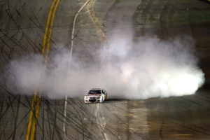 Dale Earnhardt Jr. (88) emerges from a cloud of smoke after winning the NASCAR Daytona 500 auto race at Daytona International Speedway in Daytona Beach, Fla., Sunday, Feb. 23, 2014. (AP/Phelan M. Ebenhack)