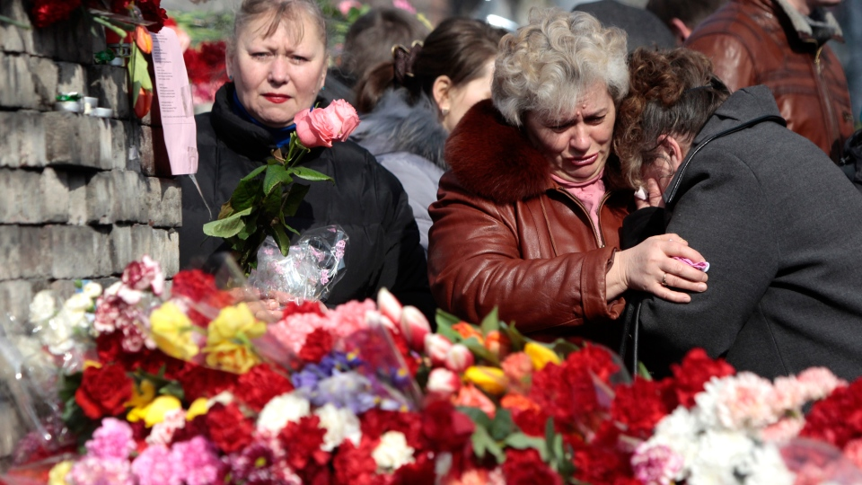 Flowers are seen placed at a barricade in Kyiv's Independence Square, the epicentre of the country's current unrest, Ukraine, Monday, Feb. 24, 2014. (AP / Sergei Chuzavkov)
