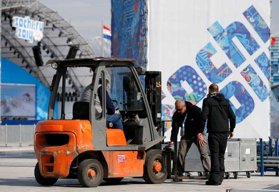 Workers pack up equipment in Olympic Park the day after the closing ceremony for the 2014 Winter Olympics in Sochi, Russia, Monday, Feb. 24, 2014. (AP / Mark Humphrey)
