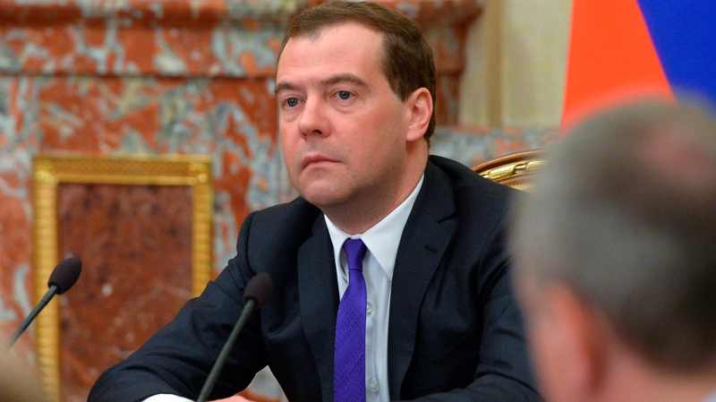 Russian Prime Minister Dmitry Medvedev heads the Cabinet meeting in Moscow on Thursday, Feb. 20, 2014. Russia would fulfill its agreements with Ukraine if the Ukrainian authorities are legitimate and effective, Prime minister Dmitry Medvedev told the Cabinet meeting on Thursday. (AP Photo/RIA Novosti, Alexander Astafyev, Government Press Service)