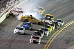 Dale Earnhardt Jr., front, leads the racers to the finish line as Kyle Busch (18) starts a collision coming out of Turn 4 during the NASCAR Daytona 500 auto race in Daytona Beach, Fla., Sunday, Feb. 23, 2014. (AP Photo/Phelan M. Ebenhack)