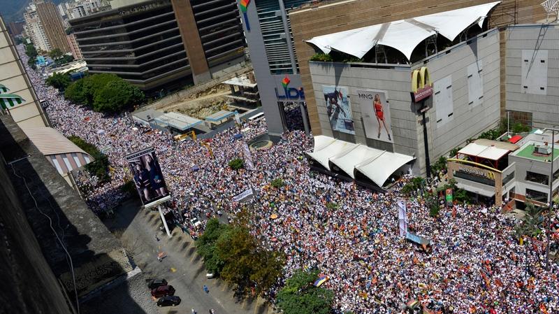 In this Saturday, Feb. 22, 2014 photo, anti-government protesters fill a major avenue in Caracas, Venezuela. (AP Photo/Carlos Becerra)