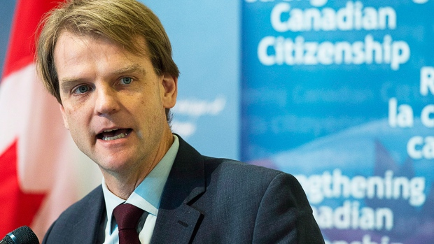 Minister Chris Alexander speaks