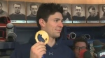 Carey Price holds the gold medal he won for his stunning goaltending at the Sochi Games (Feb. 24, 2014)