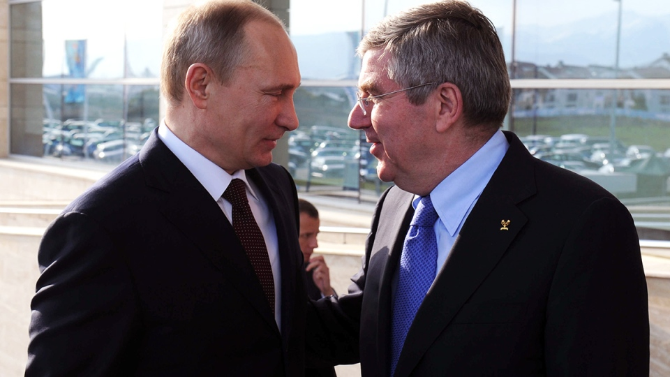 Russian President Vladimir Putin, left, talks with the International Olympic Committee President Thomas Bach prior to the official reception of IOC for Sochi 2014 Winter Olympics organizing committee in Sochi, Russia on Monday, Feb. 24, 2014. (RIA Novosti Kremlin / Mikhail Klimentyev, Presidential Press Service)