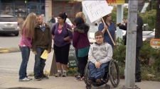 Families and advocates of the disabled protest outside Social Development Minister Harry Bloy's Burnaby office. Sept. 21, 2011. (CTV)