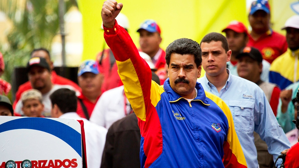 Venezuela's President Nicolas Maduro cheers during a motorcycle rally organized in support of the government in Caracas, Venezuela, Monday, Feb. 24, 2014. (AP / Rodrigo Abd)
