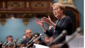 Quebec Premier Pauline Marois responds to Opposition questions over the budget speech to be tabled later in the day, Thursday, February 20, 2014 at the legislature in Quebec City. (Jacques Boissinot / THE CANADIAN PRESS)