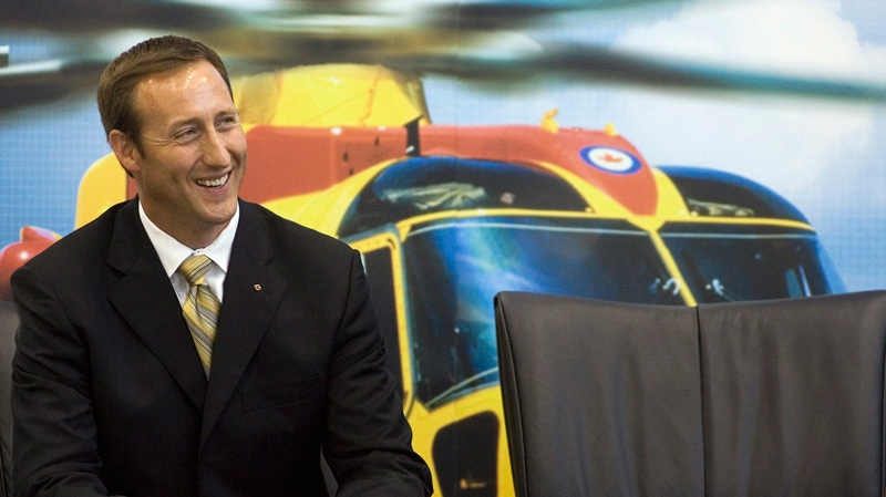 Defence Minister Peter MacKay smiles with a CH-149 Cormorants behind him in Halifax on Wednesday, Sept. 12, 2007.(Andrew Vaughan /  THE CANADIAN PRESS)
