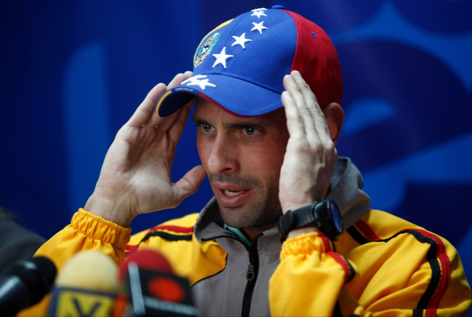 Opposition leader Henrique Capriles speaks during a news conference at his office in Caracas, Venezuela, Thursday, Feb. 20, 2014. (AP / Alejandro Cegarra)