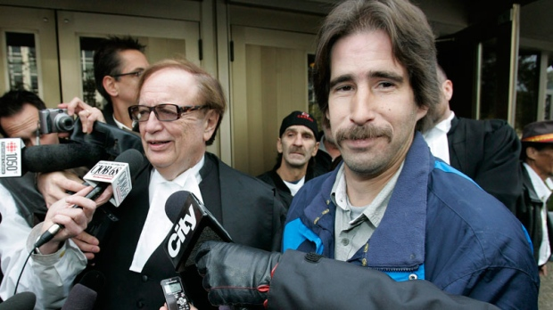 Kyle Unger, right, and his lawyer, Hersh Wolch, talk to media outside a Winnipeg courthouse on Friday, October 23, 2009. (John Woods / THE CANADIAN PRESS)