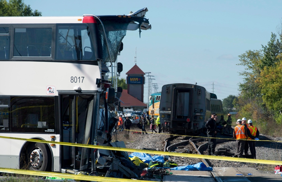 An OC Transpo bus sits where it collided with a VIA Rail train during the morning commute in Ottawa, Wednesday, Sept. 18, 2013. (Adrian Wyld / THE CANADIAN PRESS)