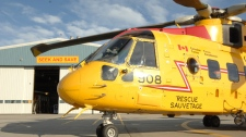 A CH-149 Cormorant sits in front of the 103 Squadron Hanger during  in Gander, N.L., on Sept. 23, 2009. (Combat Camera / Cpl. Darcy Lefebvre)