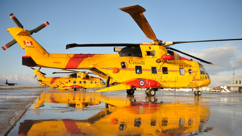 CH-149 Cormorant Helicopters are on standby at Sydney Airport just before departing for Search and Rescue Mission Cougar 91 in Sydney, N.S., on March 12, 2009. (Combat Camera / Pte. Vicky Lefrancois)