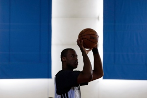 Brooklyn Nets player Jason Collins shoots during practice on the campus of UCLA in Los Angeles on Feb. 25, 2014. Collins became the first openly gay active athlete in North America's four major professional sports on Sunday after signing a 10-day contract with the Nets. (AP Photo/Reed Saxon)