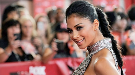 Nicole Scherzinger, a judge on 'The X Factor,' poses at a world premiere screening event for the new television series in Los Angeles, Wednesday, Sept. 14, 2011.