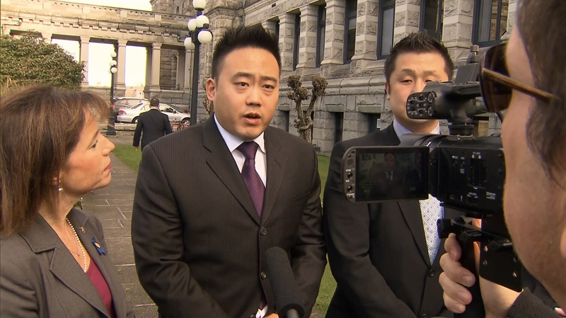 Sam Noh, centre, speaks to reporters about the Silver Alert system proposed by NDP MLA Selina Robinson, left. Noh's father, who suffered from Alzheimer's, went missing in September and hasn't been found. Feb. 25, 2014. (CTV)