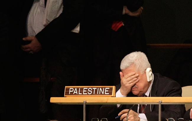Palestinian President Mahmoud Abbas rubs his eyes while U.S. President Barack Obama speaks during the 66th session of the General Assembly at United Nations headquarters Wednesday, Sept. 21, 2011. (AP / Seth Wenig)